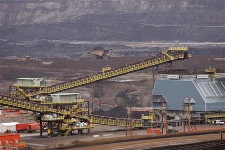 A truck drives down a street at Syncrude's oil tar sands operation near Fort McMurray, Alberta in this May 23, 2006 file photo. REUTERS/Todd Korol/Files