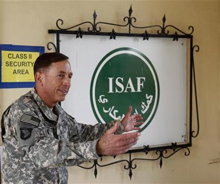 General David Petraeus, commander of ISAF and U.S. forces in Afghanistan gestures before the arrival of the president of the German lower house of parliament Norbert Lammert at the ISAF headquarters in Kabul, August 29, 2010. REUTERS/Fabrizio Bensch