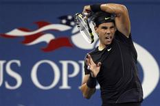 <p>Rafael Nadal of Spain returns a volley to Teymuraz Gabashvili of Russia during their first round match at the U.S. Open tennis tournament in New York, August 31, 2010. REUTERS/Shannon Stapleton</p>