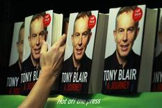 "<p>An employee poses with the political memoirs of Britain's former Prime Minister Tony Blair, ""A Journey"", in a bookshop in London September 1, 2010. REUTERS/Luke MacGregor</p>"