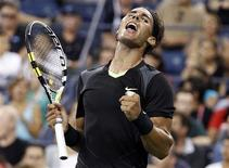<p>Number one seed Rafael Nadal of Spain celebrates winning his first round match against Teymuraz Gabashvili of Russia at the U.S. Open tennis tournament in New York August 31, 2010. REUTERS/Shannon Stapleton</p>