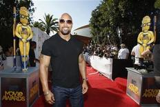 "<p>Dwayne ""The Rock"" Johnson arrives at the 2010 MTV Movie Awards in Los Angeles June 6, 2010. REUTERS/Mario Anzuoni</p>"