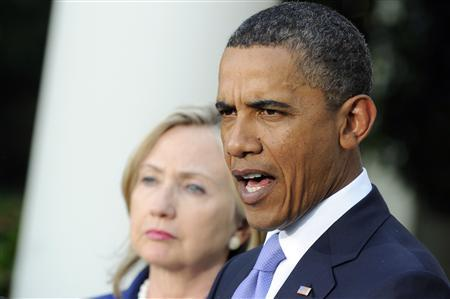 President Barack Obama is flanked by Secretary of State Hillary Clinton (L) as he makes comments on the Middle East Peace process in the Rose Garden at the White House in Washington, September 1, 2010. REUTERS/Jonathan Ernst