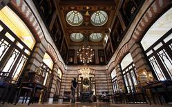 <p>A guest walks at the main lobby of the Pera Palace in Istanbul September 3, 2010. REUTERS/Murad Sezer</p>