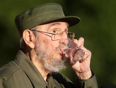 Former Cuban leader Fidel Castro drinks water during a meeting with students at Havana's University September 3, 2010. REUTERS/Desmond Boylan