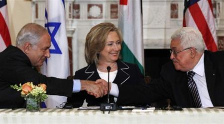 Israeli Prime Minister Benjamin Netanyahu (L) shakes hands with Palestinian President Mahmoud Abbas (R) as U.S. Secretary of State Hillary Clinton looks on at the State Department in Washington September 2, 2010. REUTERS/Jim Young
