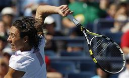 <p>Francesca Schiavone of Italy sets up for a return to Anastasia Pavlyuchenkova of Russia during the U.S. Open tennis tournament in New York, September 5, 2010. REUTERS/Kena Betancur</p>