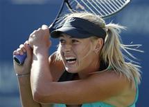 <p>Maria Sharapova of Russia follows through on a return to Caroline Wozniacki of Denmark during the U.S. Open tennis tournament in New York, September 6, 2010. REUTERS/Jessica Rinaldi</p>