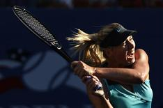 <p>Maria Sharapova of Russia follows through on a return to Caroline Wozniacki of Denmark during the US Open tennis tournament in New York, September 6, 2010. REUTERS/Jessica Rinaldi</p>