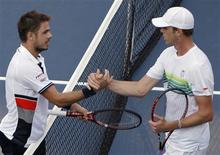 <p>Stanislas Wawrinka (L) of Switzerland shakes hands with Sam Querrey of the U.S. after winning their match during the US Open tennis tournament in New York, September 7, 2010. REUTERS/Jessica Rinaldi</p>