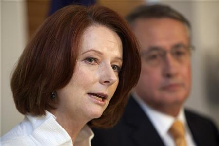 Australia's Prime Minister Julia Gillard speaks during a news conference with Treasurer Wayne Swan in Parliament House, Canberra, September 7, 2010. REUTERS/Andrew Taylor