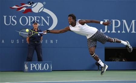 Gael Monfils of France reaches for a return to Novak Djokovic of Serbia during the U.S. Open tennis tournament in New York, September 8, 2010. REUTERS/Jessica Rinaldi