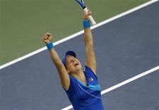 <p>Kim Clijsters of Belgium celebrates her victory against Venus Williams of the U.S. at the U.S. Open tennis tournament in New York September 10, 2010. REUTERS/Mike Segar</p>