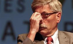 <p>German central bank executive Thilo Sarrazin attends a public reading to present his book 'Deutschland schafft sich ab' (Germany does away with itself) in Potsdam, September 9, 2010. REUTERS/Fabrizio Bensch</p>