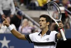 <p>Novak Djokovic of Serbia celebrates his victory against Roger Federer of Switzerland during the U.S. Open tennis tournament in New York, September 11, 2010. REUTERS/Kevin Lamarque</p>