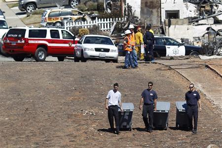 Investigators gather at the scene of a natural gas explosion in San Bruno, California September 11, 2010. REUTERS/Stephen Lam