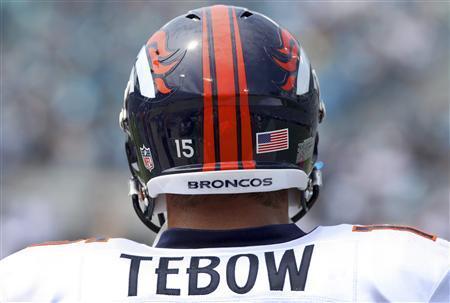 Denver Broncos quarterback Tim Tebow stands on the sideline during the first quarter of their NFL game against the Jacksonville Jaguars in Jacksonville, Florida September 12, 2010. REUTERS/Daron Dean