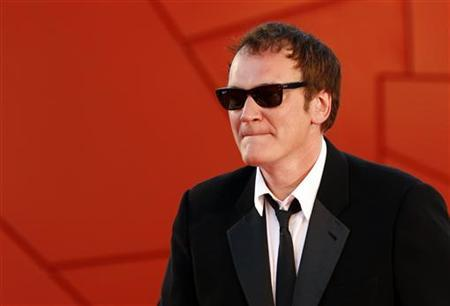 Director Quentin Tarantino arrives at the red carpet during the closing ceremony at the 67th Venice Film Festival September 11, 2010. Tarantinois the jury president of the Venice Film Festival. REUTERS/Alessandro Bianchi