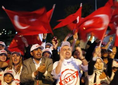 Supporters of Turkey's Prime Minister and leader of Turkey's ruling Justice and Development Party Recep Tayyip Erdogan cheer in front of the Party building in Istanbul September 12, 2010. REUTERS/Osman Orsal