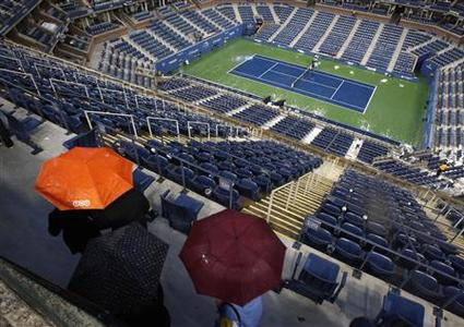 Fans walk through Arthur Ashe Stadium during a rain delay in the men's final between Rafael Nadal of Spain and Novak Djokovic of Serbia at the U.S. Open tennis tournament in New York, September 13, 2010. REUTERS/Jessica Rinaldi