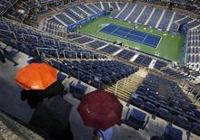 <p>Fans walk through Arthur Ashe Stadium during a rain delay in the men's final between Rafael Nadal of Spain and Novak Djokovic of Serbia at the U.S. Open tennis tournament in New York, September 13, 2010. REUTERS/Jessica Rinaldi</p>