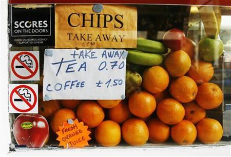 Fruit is displayed in the window of a cafe, in London July 14, 2009. REUTERS/Luke MacGregor