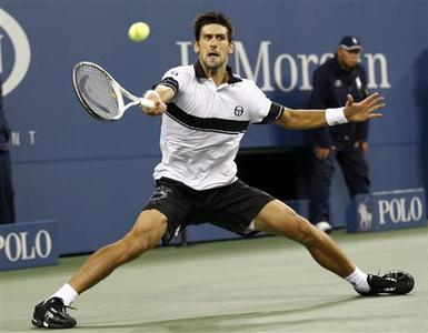Novak Djokovic of Serbia reaches for a return to Rafael Nadal of Spain during the men's final at the U.S. Open tennis tournament in New York, September 13, 2010. REUTERS/Kevin Lamarque
