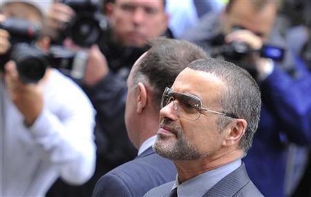 British singer George Michael arrives at Highbury Corner Magistrates Court in London, September 14, 2010. REUTERS/Toby Melville