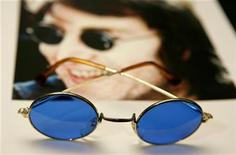 "<p>A pair of sunglasses worn by John Lennon can be seen with a photo of the famous singer as part of the ""Icons of Music"" collection of music memorabilia, auctioned off for the ""Music Rising"" benefit for Gulf Coast musicians, in New York April 16, 2007. REUTERS/Lucas Jackson</p>"