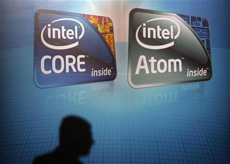A shadow is cast on an Intel advertisement at the Computex 2010 computer fair in Taipei June 1, 2010. Intel introduced a pair of new Atom processors and announced the full launch of an application store for laptops at its San Francisco developer conference. REUTERS/Pichi Chuang