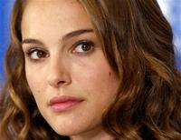 """<p>Actress Natalie Portman listens during a news conference for the film """"Black Swan"""" at the 35th Toronto International Film Festival September 14, 2010. REUTERS/Mike Cassese</p>"""