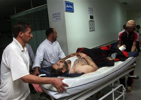 A wounded man is wheeled on a stretcher at a hospital in Falluja, 50 km (31 mi) west of Baghdad September 15, 2010. At least seven people were killed on Wednesday in a raid by Iraqi and U.S. security forces on three houses in the city of Falluja, once an al Qaeda stomping ground. At least four other people, including a 90-year-old woman, were wounded in the raid, which took place in the Hay Jubail district of Falluja in western Anbar province, police and hospital sources said. REUTERS/Mohanned Faisal
