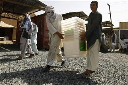 Workers carry ballot boxes to be distributed to polling stations, at counting center in Kandahar province, September 16, 2010. REUTERS/Omar Sobhani