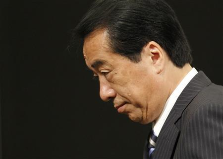Japan's Prime Minister Naoto Kan leaves a news conference after winning the Democratic Party of Japan party leadership vote in Tokyo September 14, 2010. REUTERS/Kim Kyung-Hoon