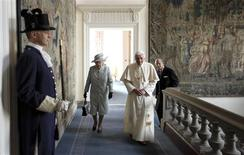 <p>Queen Elizabeth walks with Pope Benedict XVI, followed by Prince Philip, in the Morning Drawing Room of the Palace of Holyroodhouse in Edinburgh, Scotland September 16, 2010. REUTERS/Dan Kitwood/Pool</p>