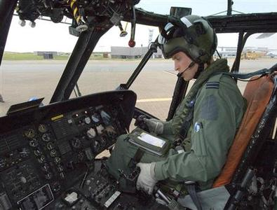 Prince William is seen sitting at the controls of his Sea King helicopter in this September 3 handout photograph received in London on September 17, 2010. REUTERS/Flight Sergeant Andy Carnall/ MoD/Crown Copyright/Pool