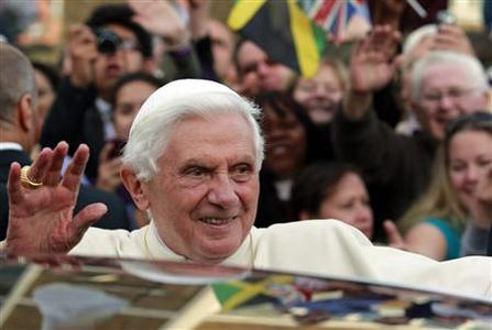 Pope Benedict XVI waves to the crowds gathered outside St Peter's Residence in London September 18, 2010. REUTERS/Lefteris Pitarakis/POOL
