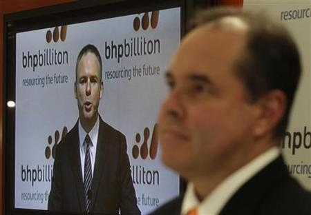 Marius Kloppers, chief executive officer of BHP Billiton, is broadcasted as he gives a speech in London as Alex Vanselow, chief financial officer listens, in Sydney August 25, 2010. REUTERS/Daniel Munoz