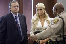 <p>Paris Hilton (C) is directed to a seat as she arrives at the courtroom with her attorney David Chesnoff (L) at the Regional Justice Center in Las Vegas, September 20, 2010. REUTERS/Las Vegas Sun/Steve Marcus</p>