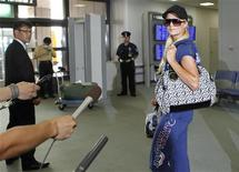 <p>Paris Hilton speaks to the media as she departs Japan from Narita International Airport in Narita, east of Tokyo, September 22, 2010. REUTERS/Toru Hanai</p>