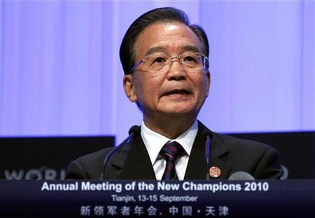 Chinese Premier Wen Jiabao speaks during the opening plenary session of the World Economic Forum at the Meijiang Convention Centre in the northern Chinese city of Tianjin September 13, 2010. REUTERS/David Gray