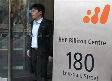A man walks out of the head offices of BHP Billiton in central Melbourne in this September 22, 2010 file photo. REUTERS/Mick Tsikas