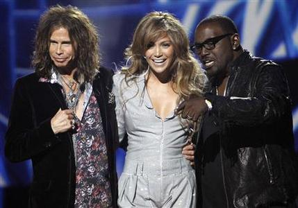 Steven Tyler, Jennifer Lopez and Randy Jackson stand together after being announced as the judges for the 10th season of the television show ''American Idol'' at the Forum in Inglewood, California September 22, 2010. REUTERS/Mario Anzuoni