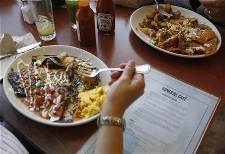 Customers eat breakfast at Homegirl Cafe in Los Angeles, April 23, 2010. REUTERS/Lucy Nicholson