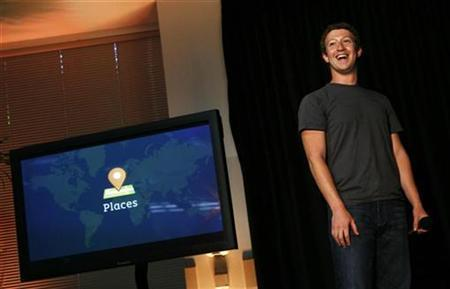 Facebook CEO Mark Zuckerberg smiles while unveiling the company's new location services feature called ''Places'' during a news conference at Facebook headquarters in Palo Alto, California August 18, 2010. REUTERS/Robert Galbraith