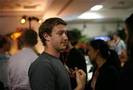 Facebook CEO Mark Zuckerberg walks among the crowd gathered prior to unveiling the company's new location services feature called ''Places'' during a news conference at Facebook headquarters in Palo Alto, California in this August 18, 2010 file photo. REUTERS/Robert Galbraith