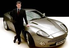 <p>James Bond actor Pierce Brosnan poses for photographers with an Aston Martin V12 Vanquish, at Pinewood Studios in London in this file photo. REUTERS/Ferran Paredes</p>