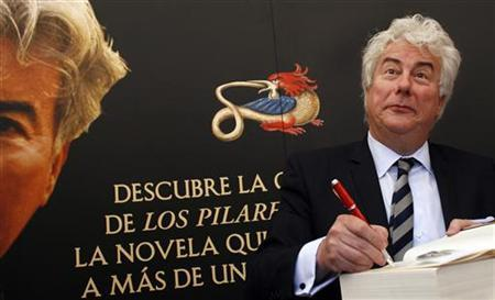 Ken Follett gestures during a book signing of his novel ''World without end'' at Madrid's Book Fair June 14, 2008. REUTERS/Susana Vera