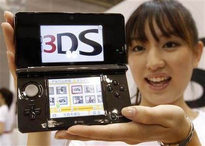 A model poses with Nintendo Co Ltd's new 3DS handheld game console in Chiba, east of Tokyo September 29, 2010. REUTERS/Toru Hanai