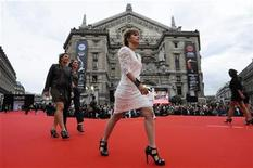 <p>Models present their own creations on a giant red carpet runway behind the Paris Opera House in the central shopping district as part of events during the Paris Fashion Week September 30, 2010. REUTERS/Gonzalo Fuentes</p>